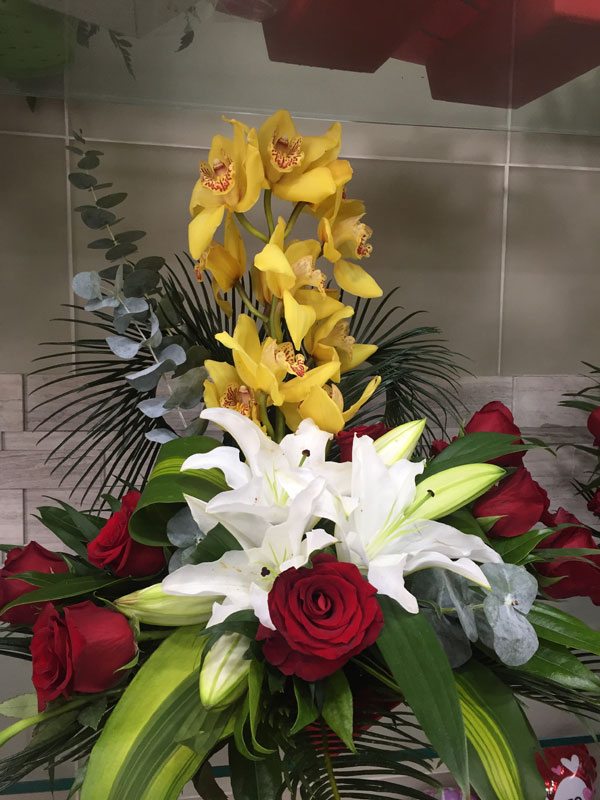 Yellow White And Red Tropical Flower Arrangement